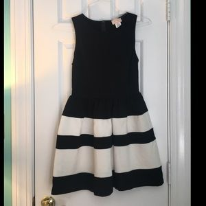 Black and white striped fit an flare dress